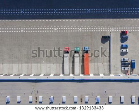 Aerial view of trucks unloading in logostics center  #1329133433