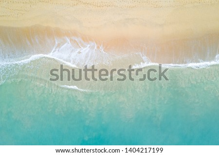 Aerial view of turquoise ocean wave reaching the coastline. Beautiful tropical beach from top view. Andaman sea in Thailand. Summer holiday vacation concept #1404217199