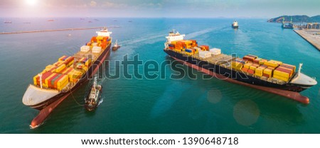 aerial view of two container ships are going to the entrance channel due of an international port for loading and discharging shipment, transport and logistics services to the cargo transhipment