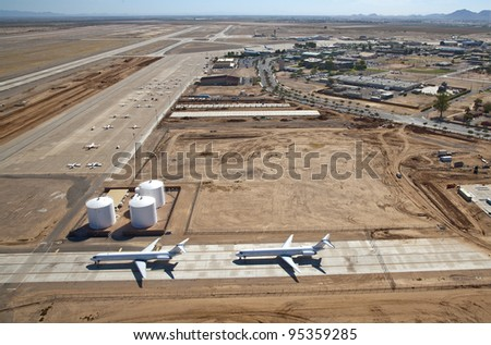 Aerial view of two jets parked on taxiway at airport