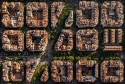 Aerial view of typical buildings of Barcelona cityscape from helicopter. top view, Eixample residencial famous urban grid