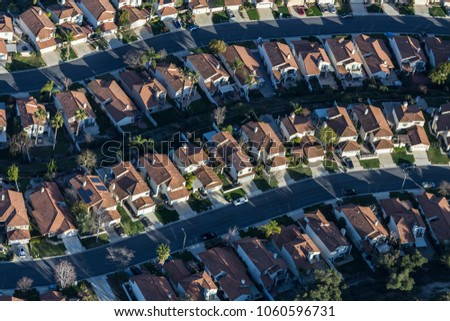 Aerial view of typical neighborhood homes and streets in suburban Thousand Oaks, California.