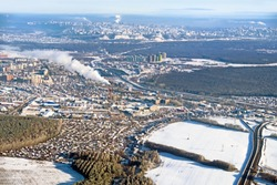 Aerial view of Ufa city russia white winter skyline. Big russian industrial cityscape from air. Satellite imagery of earth landscape at cold season. Town district road forest and snow scenery landmark