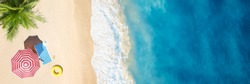 Aerial view of umbrella,towel on sand beach.Copy space for your text.