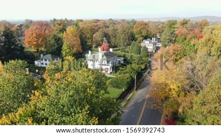 Aerial view of upscale suburban residential area with luxury villas and mansions surrounded by trees and greenery, real estate and architecture concept, fancy neighbourhood #1569392743