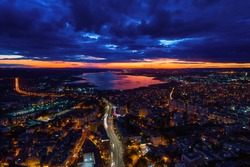 Aerial view of Varna city centre at sunset. Night urban landscape.