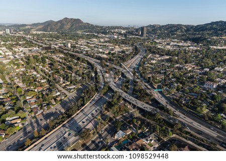 Aerial view of Ventura 101 Freeway and Hollywood 170 freeways in the San Fernando Valley area of Los Angeles, California. #1098529448