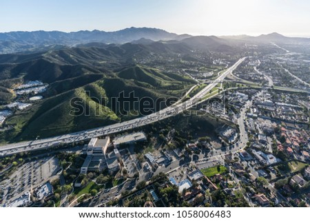 Aerial view of Ventura 101 freeway and suburban Thousand Oaks near Los Angeles, California. #1058006483