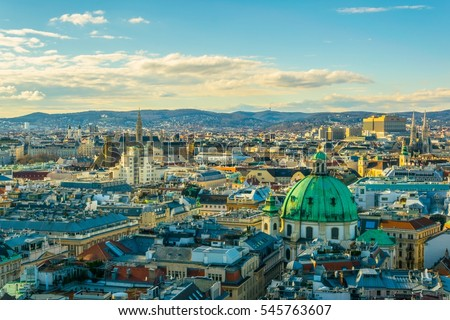 Aerial view of Vienna with tower of the town hall building, votivkirche and peterskirche churches from the stephansdom cathedral.