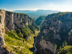 Aerial view of Vikos Gorge, a gorge in the Pindus Mountains of northern Greece, lying on the southern slopes of Mount Tymfi, one of the deepest gorges in the world. Zagori region, Greece.