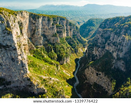 Aerial view of Vikos Gorge, a gorge in the Pindus Mountains of northern Greece, lying on the southern slopes of Mount Tymfi, one of the deepest gorges in the world. Zagori region, Greece. #1339776422