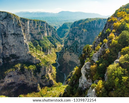 Aerial view of Vikos Gorge, a gorge in the Pindus Mountains of northern Greece, lying on the southern slopes of Mount Tymfi, one of the deepest gorges in the world. Zagori region, Greece. #1339872254