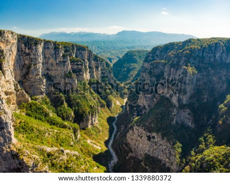 Aerial view of Vikos Gorge, a gorge in the Pindus Mountains of northern Greece, lying on the southern slopes of Mount Tymfi, one of the deepest gorges in the world. Zagori region, Greece. #1339880372