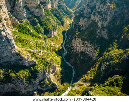 Aerial view of Vikos Gorge, a gorge in the Pindus Mountains of northern Greece, lying on the southern slopes of Mount Tymfi, one of the deepest gorges in the world. Zagori region, Greece. #1339884428