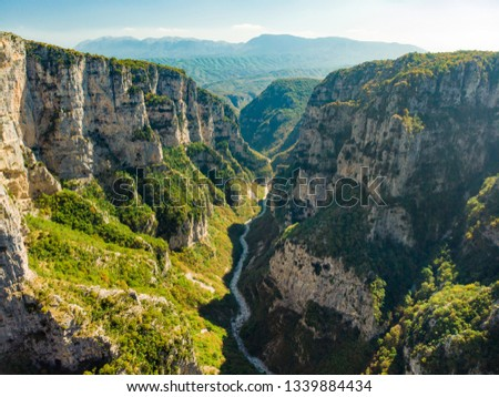 Aerial view of Vikos Gorge, a gorge in the Pindus Mountains of northern Greece, lying on the southern slopes of Mount Tymfi, one of the deepest gorges in the world. Zagori region, Greece. #1339884434