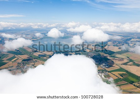 aerial view of village landscape  near Otmuchow town over clouds in Poland