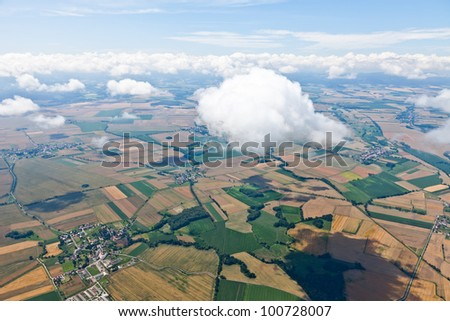 aerial view of village landscape  over clouds in Poland