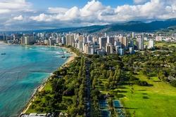Aerial view of Waikiki skyline with park district leading to Honolulu city. Afternoon light. Oahu Island, Hawaii
