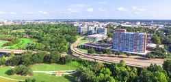 Aerial view of Washington heights ward from Eleanor Tinsley Park, with Buffalo Bayou river and Intersection of Memorial Dr and Sawyer St. Green park, residential and office buildings. Panorama