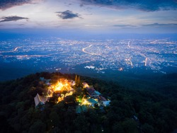 Aerial view of Wat Phra That Doi Suthep Temple at sunrise on the top of Doi Suthep mountain in Chiang Mai, Thailand.
