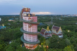 Aerial view of Wat Samphran or Chinese Dragon Temple in Sam Phran District in Nakhon Pathom province near Bangkok Urban City, Thailand. Tourist attraction landmark in travel trip concept.