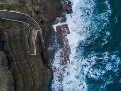 Aerial view of wave around Bogey Hole, Newcastle, Australia.