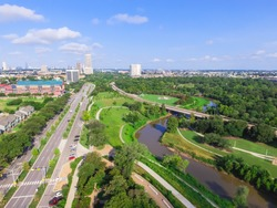 Aerial view of west-central area in Houston from Buffalo Bayou Park. Foreground is historic Fourth Ward, Allen Parkway, Memorial Parkway, Buffalo Bayou river, mid-town high-rise buildings in distance