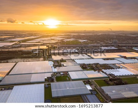 Aerial view of Westland or glass city Greenhouse horticulture area in the Netherlands. One of the biggest food production areas in the world an a huge engine of the dutch economy. Сток-фото ©