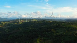 Aerial view of wind turbines and wind mills for electric power production in the Philippines, Luzon.
