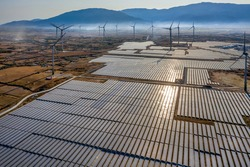 Aerial view of windmill and Solar panel, photovoltaic, alternative electricity source - concept of sustainable resources on a sunny day, Bac Phong, Thuan Bac, Ninh Thuan, Vietnam