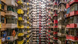 Aerial view of Yick Fat Building, Quarry Bay, Hong Kong. Residential area in old apartment with windows. High-rise building, skyscraper with windows of architecture in urban city.