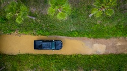 Aerial view off-road car vehicle, car 4x4 wheel drives off-road, Black truck car 4x4 adventure over river view from above.