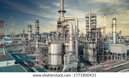 Aerial view Oil and gas industrial, Oil refinery plant form industry, Refinery factory white oil storage tank, Oil refinery plant from industry zone.