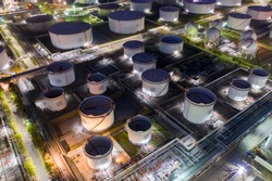 Aerial view oil and gas industrial, Refinery factory oil storage tank and pipeline steel at night