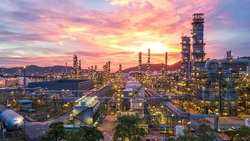 Aerial view Oil refinery. Industrial view at oil refinery plant form industry zone with sunrise and cloudy sky.