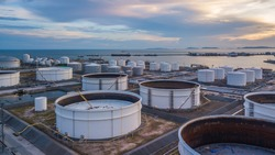 Aerial view oil storage tank terminal and tanker, petrol industrial zone.