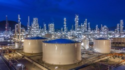 Aerial view oil storage tank with oil refinery background, Oil refinery plant at night.