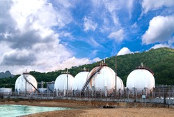 Aerial view oil tank of petrol industrial zone with mountain background