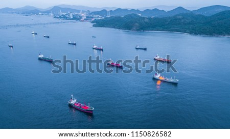 Aerial view oil tanker and gas tanker loading in port in sea at twilight.