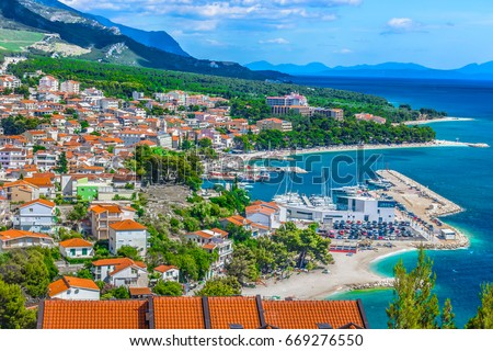 Aerial view on Adriatic Sea and Baska Voda place in Makarska Riviera, Dalmatia region, popular tourist summer resort in Croatia, Mediterranean. / Selective focus. Stock fotó ©