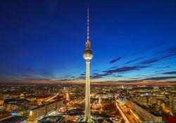 Aerial view on Alexanderplatz at night, Berlin, Germany