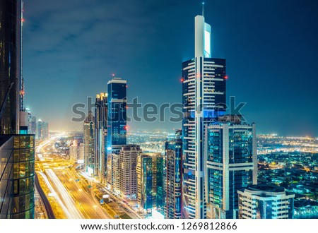 Aerial view on downtown Dubai, UAE with highways and skyscrapers. Scenic nighttime skyline. #1269812866