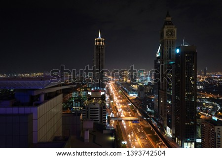 Aerial view on downtown Dubai, UAE with highways and skyscrapers. Scenic nighttime skyline #1393742504