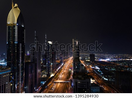 Aerial view on downtown Dubai, UAE with highways and skyscrapers. Scenic nighttime skyline #1395284930