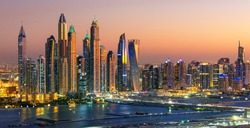 Aerial view on Dubai Marina with skyline - luxury and famous Jumeirah beach frontline at sunrise, United Arab Emirates