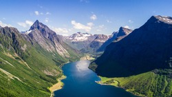 Aerial view on Geiranger town, harbor and fjord in More og Romsdal county in Norway famous for his beautiful boattrip through the fjord.