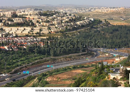 Aerial view on highway among hills and city quarters of Jerusalem, Israel.