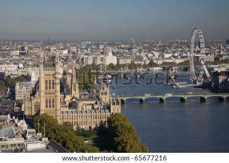 Aerial view on Houses of Parliament, London Eye and Westminster Bridge on Thames River.