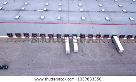 Aerial view on loading bays in distribution center. Aerial #1039833550