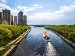 Aerial view on Moscow canal in northwest of Moscow and cargo ship with sand sailed through the canal.